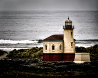 Dark Lighthouse Against a Sullen Sea